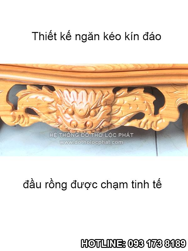 phần đầu rồng và ngăn kéo bàn thờ thần tài mái chùa được chạm tinh tế