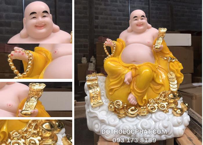 tượng di lặc màu vàng hổ phách tay cầm gậy như ý cao 40cm